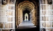 A Stone Arch Hallway At A Univ...