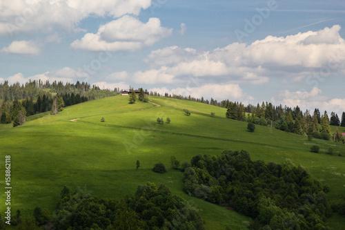 Fotobehang Rijstvelden Green mountain hill with clody blue sky