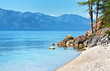 Lake Baikal in the summer. Pebble beach on the shore of the Chivyrkuy Bay