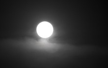 The Moon In The Haze Of The Cl...