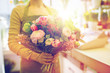 Leinwandbild Motiv close up of woman holding bunch at flower shop