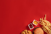 Burger And Chips. Hamburger And French Fries In Red Paper Box. Fast Food On Red Background.