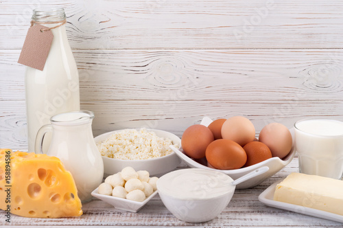 Poster Zuivelproducten Dairy products on wooden table. Milk, sour cream, cheese, egg, yogurt and butter. Healthy eating and diet concept. Copy space