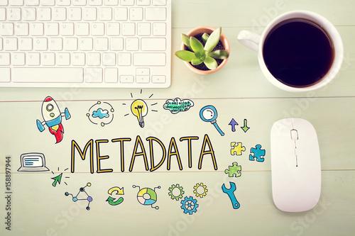 Fotografia, Obraz  Metadata concept with workstation on a light green wooden desk