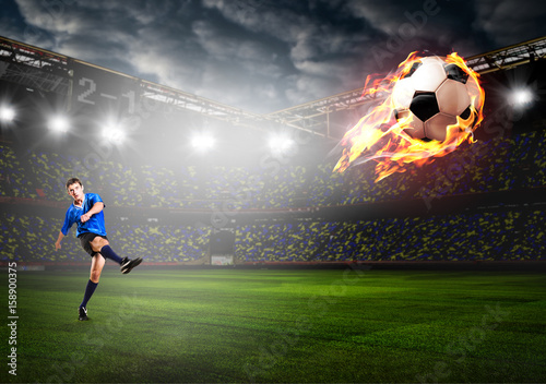 soccer-or-football-player-is-kicking-ball-on-stadium