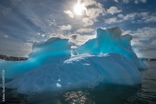 Photo sur Toile Antarctique Azure shimmering translucent iceberg in Antarctica