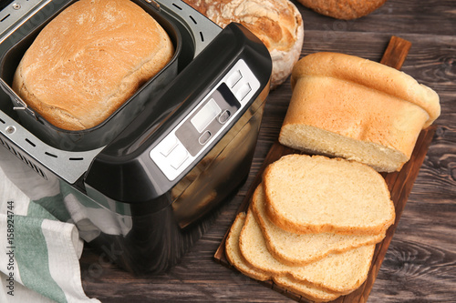 Deurstickers Brood Loaf baked in bread machine on wooden table