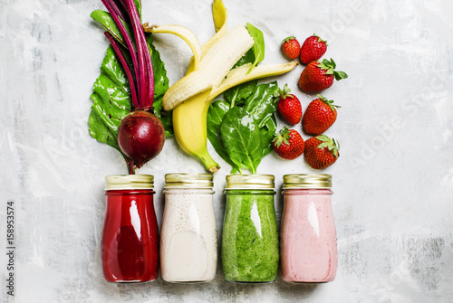 Staande foto Sap Multicolored juices and smoothies of fresh vegetables, fruits and berries, top view, food background