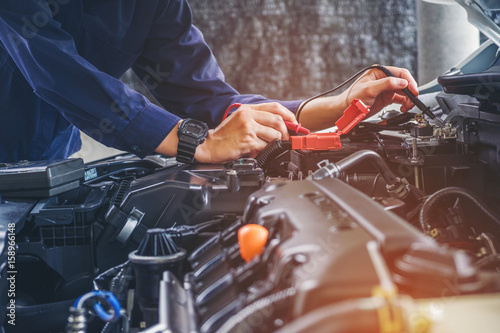 plakat Hands of car mechanic working in auto repair service.