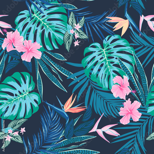 Obraz Vector seamless tropical pattern, vivid tropic foliage, with monstera leaf, palm leaves, bird of paradise flower, hibiscus in bloom. modern bright summer print design - fototapety do salonu