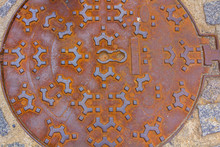 Decorated And Rusty Culvert Lid