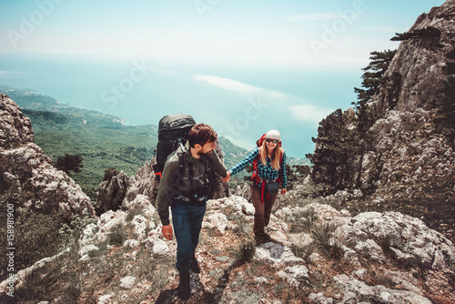 Couple Man and Woman holding hands hiking at mountains Love and Travel Lifestyle concept Poster