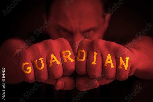 GUARDIAN written on an angry man's fists Poster