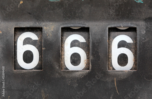 number 666 on old rusty counter of fuel pump Poster