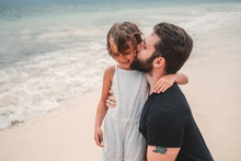 Father Kissing Daughter On Beach, Cancun, Mexico