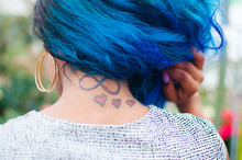 A Woman Showing Her Tattoos