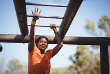 Determined Woman Exercising On...