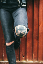 Womans Tattoo On Her Knee Spelling 'why'