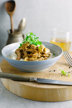 Stroganoff With Rice And A Glass Of Wine