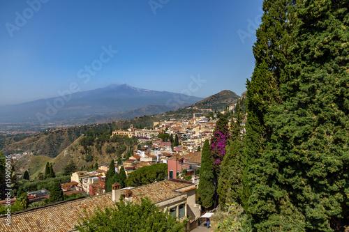 Fotografie, Obraz  Aerial view of Taormina city and Mount Etna Volcano - Taormina, Sicily, Italy