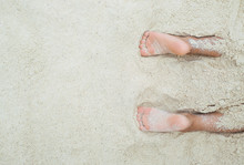 Kids Feet Covered With Sand