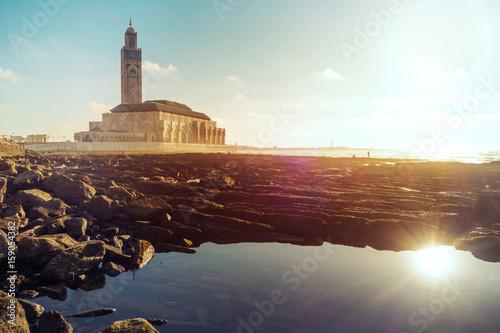 Staande foto Marokko view of Hassan ii mosque from a rocky beach