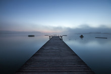 Wooden Dock On A Lake In Morni...