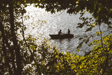 A Romantic Couple Goes For A Quaint Row Boat Ride