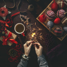 Woman Holding A Christmas Sparkler