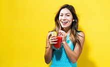 Happy Young Woman Drinking Smoothie