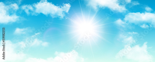 Sunny background, blue sky with white clouds and sun © Cobalt