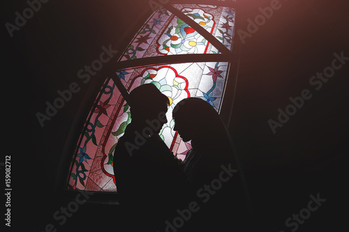 Fotografie, Obraz  Muslim couple in a mosque stained glass, Islamic religious wedding ceremony - nikah