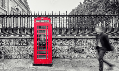 red-telephone-booth-on-street-in