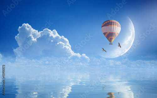 Dream come true concept - hot air balloon in blue sky