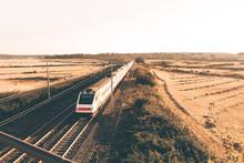 High Speed Train Is Passing Under The Bridge