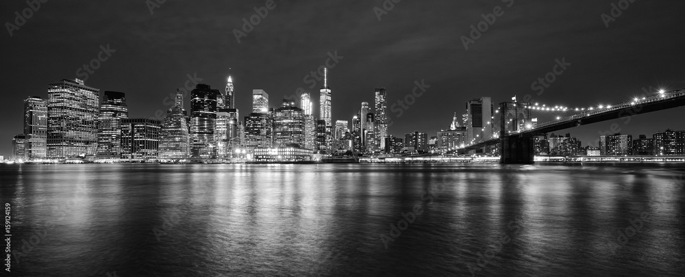 Fototapeta Black and white panoramic photo of Manhattan at night, New York City, USA.