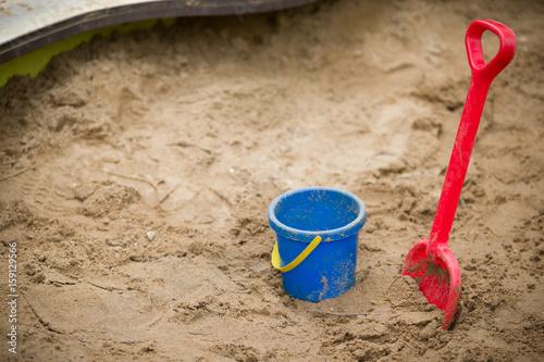 Fotografie, Obraz  Children plastic shovel and pail in the sandbox