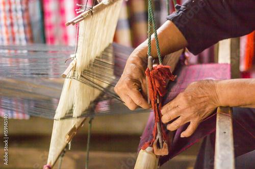 silk weaving at north Thailand. Fototapeta