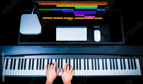 music production technology, male composer hands working on piano keys with comp Canvas Print