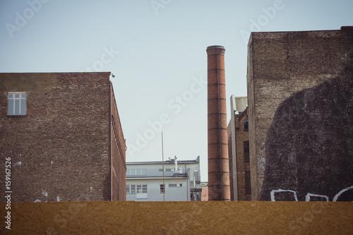 Staande foto Industrial geb. Old factory building with industrial brick chimney
