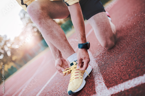 Foto op Canvas Gymnastiek Tying sports shoes. Sport, exercise, fitness, workout