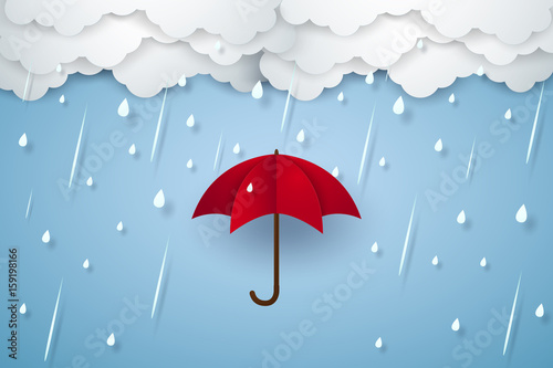 Fotografia Umbrella with heavy rain , rainy season , paper art style