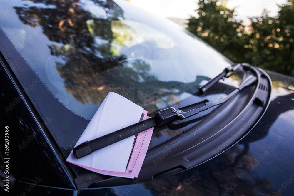 Fototapety, obrazy: A fine on a car