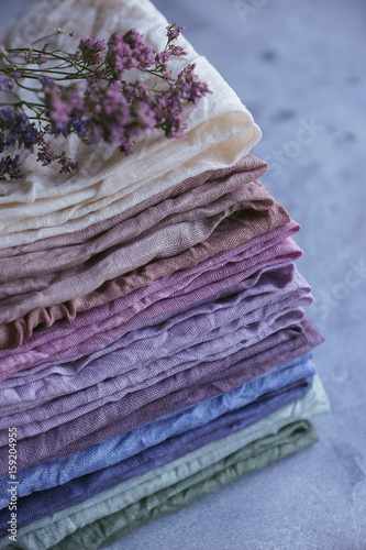 Fotografie, Obraz  Natural hand-dyed fabrics, Linen, Stack of fabric, Pastel colors