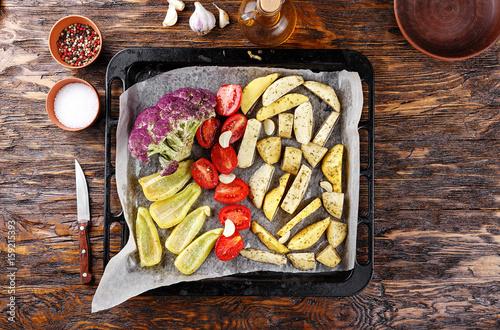 Valokuva  Raw vegetables on a baking sheet