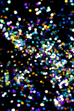 Glitter Bokeh Confetti On Black Background
