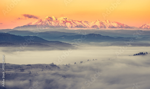 Poster Taupe Beautiful spring panorama over misty Spisz highland to snowy Tatra mountains in the morning, Poland