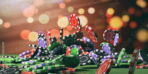 Valokuva Casino chips falling on green felt. 3d illustration