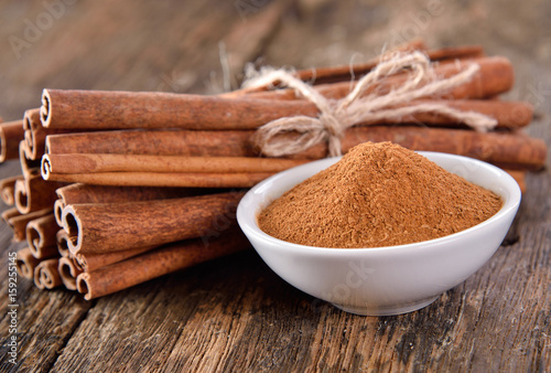Canvas Prints Condiments Cinnamon powder in a bowl on table wooden