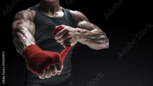 Valokuva Close-up photo of strong man wrap hands on black background with copy space for